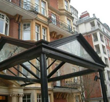 Painted aluminium, glazed canopy with frosted gables end and glass panels to London hotel entrance