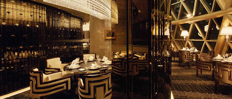 Robuchon au Dome restaurant at the top of the Grand Lisboa hotel in Macau with coloured stainless steel fixtures