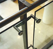 Forged and machined stainless steel uprights and handrail with toughened glass balustrade panels