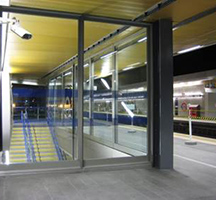 Glazed screen with stainless steel frame to Wood Lane underground station, London UK