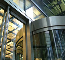 Glazed, stainless steel revolving doors to office development in Canary Wharf, London, UK