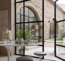 Steel framed windows in refurbishment project by interior designer Marie-Laure Helmkampf