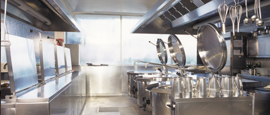 Hotel kitchen interior, London UK - Commercial kitchen deep fat fryers, units and extractors in stainless steel with antimicrobial finish