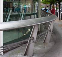Vehicle barrier at Bermondsey underground station, London, UK in shot-peened stainless steel