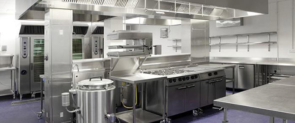 Commercial Kitchen With Extensive Use Of Stainless Steel For Surfaces And Units