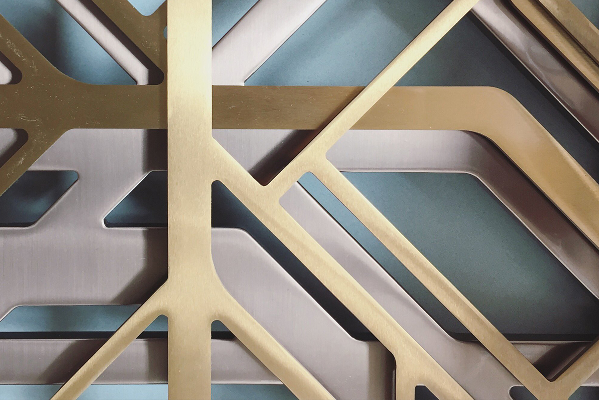 Three-layered laser-cut screens used as decorative wall façade in Double Stone Steel PVD colored stainless steel Champagne Brush, Brass Brush and powder-coated stainless steel in bronze. - Axtell House, London UK. - Architects: Darling Associates - Double Stone Steel