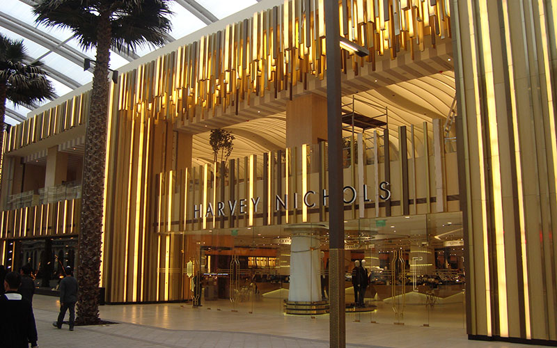 PVD coated coloured stainless steel façade, Harvey Nichols, The Avenues, Kuwait Client: Four IV Interior Design - Architect: Gensler - Developer: Mabanee