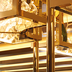 V-grooved and folded Double Stone Steel PVD stainless steel in Brass Mirror for glass rack over bar, Devonshire Club Hotel, London.