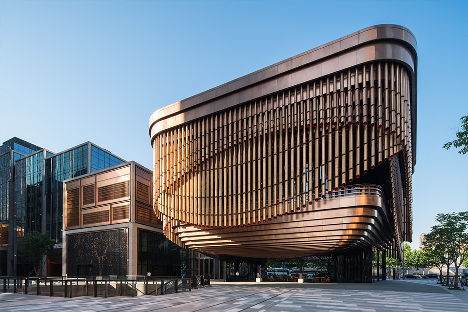 Double Stone Steel PVD stainless steel in Rose Gold for façades and tubular drops: John Desmond Ltd. The Arts and Cultural Centre, Shanghai Bund Financial Centre, China. - Architects: Foster & Partners; Heatherwick Studio