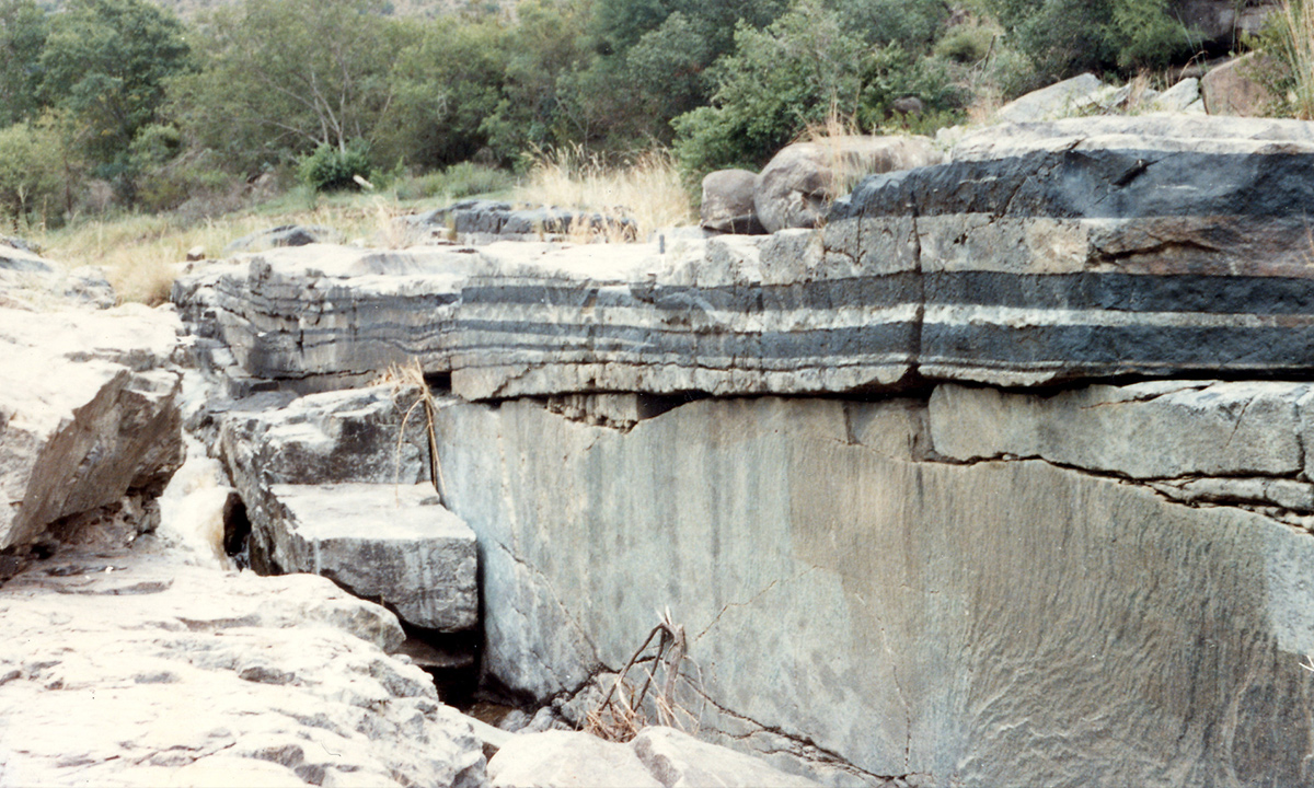 The vast Bushveld Igneous Complex of South Africa is a large layered mafic to ultramafic igneous body with some layers consisting of 90% chromite making the rare rock type, chromitite.