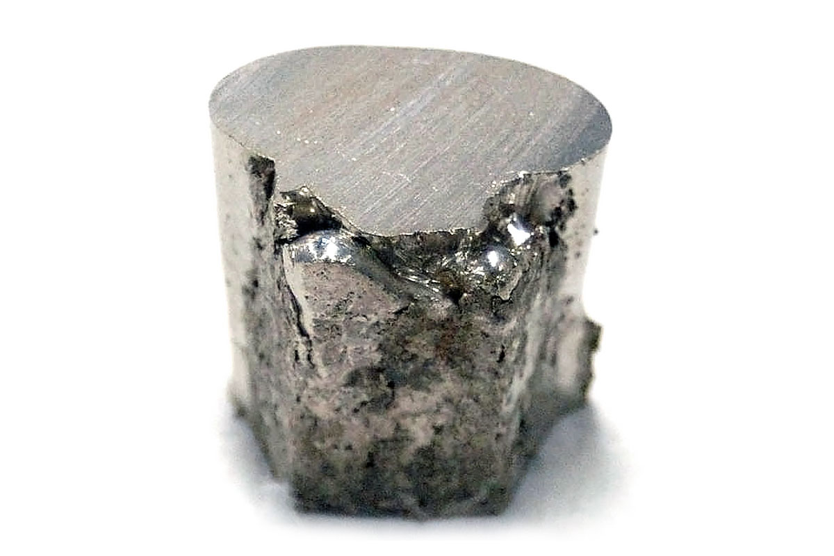 A piece of the chemical element nickel (Ni). Nickel is resistant to corrosion and is used pre-eminently as an alloying metal in nickel steels and nickel cast irons.