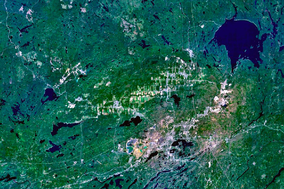The Sudbury and Wanapitei impact craters in Ontario, Canada were created by asteroids crashing into the earth billions of years ago. The nickel-rich Sudbury Basin is the large, elliptical structure (60 x 30 km).