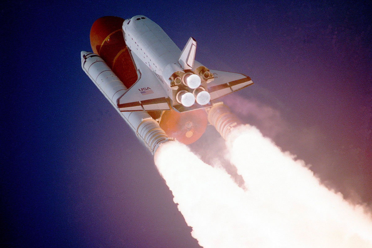 NASA space shuttle and launcher rockets heading into space after take-off. Nickel and other metals are used to create high strength metal alloys for construction.